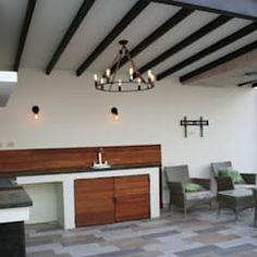 area de asador y sala: Terrazas de estilo  por Daniel Teyechea, Arquitectura & Construccion