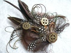 Brown Steampunk Brooch by Order Now from Gothic Diva Designs Specialising in Fabulous Elegant Gothic, Victorian Vintage & Steampunk inspired wedding designs, Including mini hat fascinators, formal hats, feathered hair clips, ostrich & peacock feather fans, black wedding bouquets, bandeau veils, buttonholes, brooches and wristlets. www.gothicdivadesigns.co.uk #Gothic #Steampunk #Halloween #Wedding #gothicwedding #gothicbride #gothbride #blackweddingscheme #elegantgoth #gothicglam…