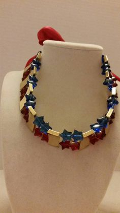 Check out this item in my Etsy shop https://www.etsy.com/listing/195859146/star-necklace-red-necklace-blue-necklace