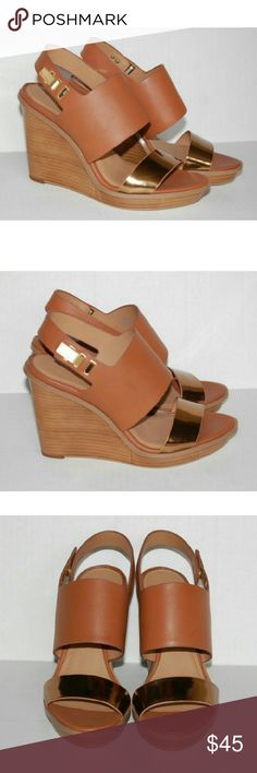 """New Calvin Klein Perdita wedge leather sandals 8M Cognac/metallic. New without box. Leather and synthetic upper/leather lining/synthetic sole. Open toe. Lightly padded insole. Ankle strap w/adjustable buckle closure. 4.25"""" heel. 0.75"""" platform. Calvin Klein Shoes Wedges"""