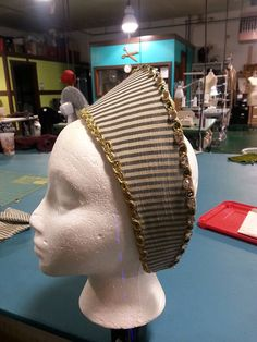 You will look stunning in this Renaissance style French hood. The Base made out of plastic artist canvas and millinery wire and is covered in quilting batting. The base is then covered in velvet (or other custom fabric) and trim, Jewels, and other embellishments are added to the