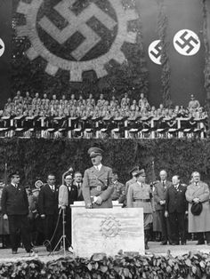 Hitler laying the foundation stone of the KDF-Wagen (Volkswagen) factory at Fallersleben (Wolfsburg). Ferdinand Porsche at far right, engineer of the VW and the Porsche.