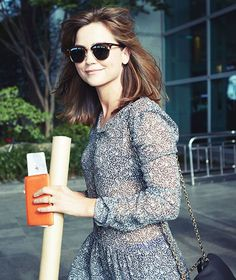 Jenna Coleman smiles for the cameras as she exits Incheon airport