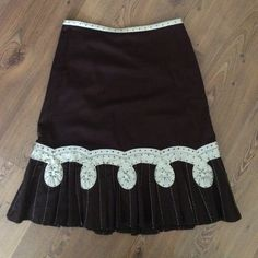 Anthropologie Vintage Style Skirt Anthropologie Brown Vintage Style Odille Skirt with cream and black polka dot accent.  Has side zipper and eyelet hook closure.  Also has brown inner lining.  This is a Gorgeous Skirt! Size 6 Anthropologie Skirts A-Line or Full