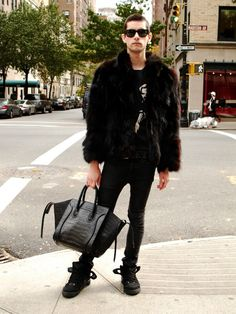 NYC The perfect balance of high fashion - Celine Phantom black croc bag and shaggy fur coat - and urban street style - high top trainers with a band style tee.