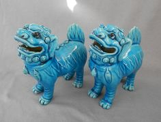 Vintage 1960s Chinese Porcelain Standing Turquoise Foo Dog Pair . . . Very striking detail, with fierce fangs and hand-sculpted tongues. Design patterns and beaded decoration appear all over!
