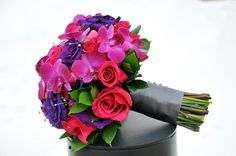 Multicolored wedding bouquet with bright colors - pink, coral, purple