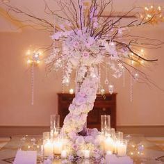 Soft pale roses cascading from branches dripping with crystals and candles // The Wedding Central HD Video and Photography // Centerpiece: Laurelwood Designs