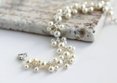Ivory Pearl Cluster Bracelet with cream Swarovski pearls and sterling silver. By OpheliasJewels, $52.00