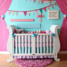 Adorable pink, aqua and chevron nursery!