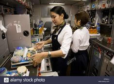member-of-cabin-crew-preparing-meals-in-the-galley-on-a-gulf-air-airbus-B79NCJ.jpg (1300×956)