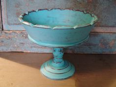 Could be made with an old votive base and a plate. Or terycota vase upside down with a large bottom put on top