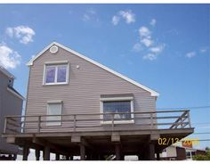 $475,000   DIRECT OCEANFRONT W/SOUTH RIVER VIEWS. ENJOY BEAUTIFUL SUNRISES & SUNSETS! RE-BUILT IN 1982 ON PILINGS W/AN OPEN FLOOR PLAN. CATHEDRAL CEILING LIVING ROOM & DINING ROOM W/ACCESS TO WRAP-AROUND DECK ON ALL SIDES OF HOME. THREE BEDROOMS AND 1. 5 BATHS WITH STACKED ENERGY STAR WASHER/DRYER. ENDLESS POSSIBILITIES! ADD YOUR PERSONAL TOUCH & STYLE TO MAKE THIS YOUR OWN! HERE IS THE PRICE POINT YOU HAVE BEEN WAITING FOR. . . COME HAVE A LOOK !!!
