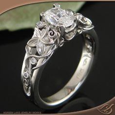 Green Lake Jewelry Style # 56560 #Engagement # Jewelryworks.. A timely fabricated 5-Petal Plumeria Flower on each side with Filigree wire Vines with little Diamonds.. Perfect for the Gardener!!