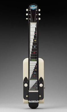 Lap steel guitar (Dynamic model)    Valco (National brand), 1952  81.3 x 16.5 x 3.8 cm (32 x 6 1/2 x 1 1/2 in.)  Maple, plastic, steel