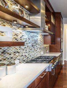 Complete your beautiful contemporary kitchen with a mosaic tile back splash that compliments your counter top and cabinet finish!