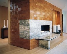 woven burled-wood wall | blue marble fireplace | by jamie herzlinger