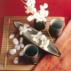 "Altar idea--Incense ""bowl"" can hold water, flowers and bamboo mat represent earth, incense for air.  All we're missing is a candle.  And, a deity if you're so inclined."