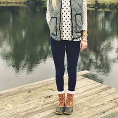 Polka dots with textured vest, dark wash jeans, and boots