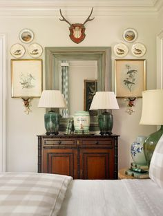 Beautiful symmetry - antlers, plates and artwork on brackets, green accents, great lamps - James T. Farmer, Son's Retreat – Showhouse