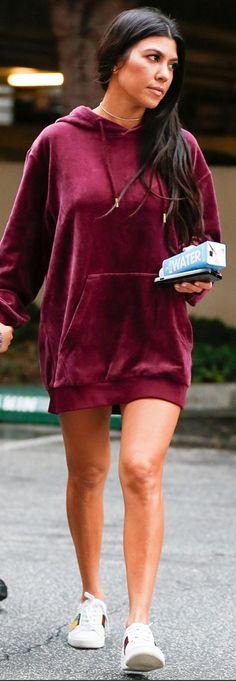 Who made  Kourtney Kardashian's white sneakers and red velvet sweatshirt?