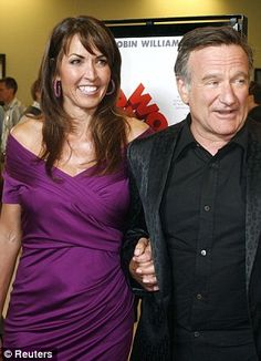 Devastating: Robin Williams with his wife, Susan Schneider, who he married in 2011. She released a statement on Monday after his tragic death