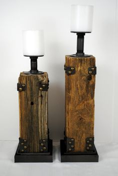 These beautiful upcycled pillar candle holders are handmade from reclaimed fence posts and wrought iron fixtures. Two sizes are available - small is