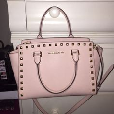 Selma Michael Kors studded tote 100% authentic Gorgeous! Pink muted pastel color like new! No stains I used it for one month but I just bought a Rebecca Minkoff  ☺️ pictures do not do it justice this is a beauty and hard to find! Medium size Michael Kors Bags