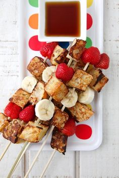 French toast on a stick is easy and fun to eat! Mixed with bananas and strawberries and maple syrup for dipping adds to kids loving this recipe!