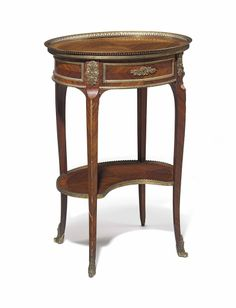 A FRENCH ORMOLU-MOUNTED MAHOGANY GUERIDON -  BY MAISON KRIEGER, PARIS, LATE 19TH/EARLY 20TH CENTURY
