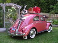 1957 VW bug in Coral Red