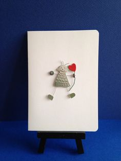 Metal boy holding a red heart on a stem card. by JuzooCrafts