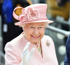 The monarch waved to well-wishers who had gathered at Lime Street station to greet the roy...