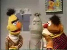 ernie makes a clay sculpture of bert