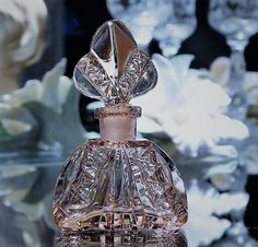 ITEM #071701  An Art Deco, circa 1920s-30s, miniature Irice Czech cut rare pink Rosaline crystal perfume bottle. Pink/Rosaline bottles are rather uncommon and this example has very nice cutting. The base is acid-stamped Made in Czechoslovakia along with the Irice sticker stating Czechoslovakia as well. Bottle stopper has the glass dauber, which is still intact.  Bottle measures 3 tall, Condition : Very good antique condition with typical wear due to age and handling. I found no damage, j...