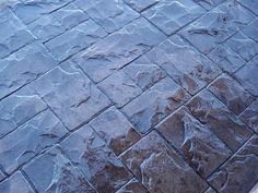 Foundation Armor AR500 High Gloss Coating on Stamped Concrete Driveway.  http://www.foundationarmor.com/high-gloss-concrete-paver-sealer