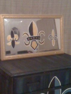 Painted Fleur De Lis on an old mirror