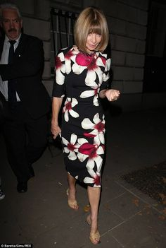 Flower power: Anna Wintour looked sophisticated in a flattering figure-hugging dress