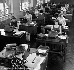 "So many women in the work place. I still get the feeling their work was not ""as important"".  1950s office lined with secretary desks"