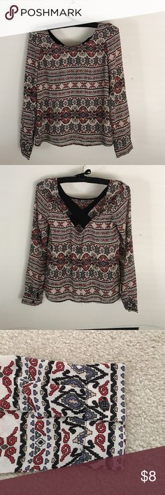 Charlotte Russe Long Sleeve Top Charlotte Russe long sleeve patterned top.  Gently worn, sheer patterned fabric, 100% polyester.  Back is somewhat low cut with black criss cross design. Charlotte Russe Tops Blouses