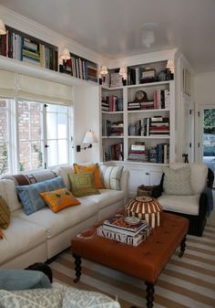 THIS is what I need!! A living room library.. lotsa shelving!