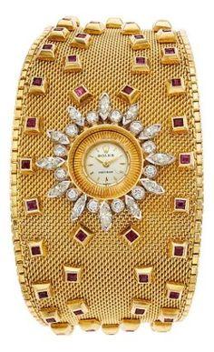 54319: Retro Rolex Lady's Diamond, Ruby, Gold Bracelet