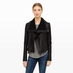 VEDA's emphasis on perfecting the leather jacket is evident with the Max—a modern interpretation of the classic leather jacket. Crafted in an exclusive pebbled leather, the Max features ribbed paneling at the sleeves and a high funnel neck that can be worn open for a sculptural, exaggerated lapel look. Leather Slim fit High funnel neck with snap-button closure; asymmetrical zip front; angled, zip welt pockets at left chest and sides; rib-k