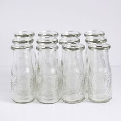 Small Glass Milk Bottles - traditional - food containers and storage - Bake It Pretty Small Milk Bottles, Glass Milk Bottles, Bottles And Jars, Glass Bottles, Milk Jars, Used Wedding Decor, Rustic Garden Wedding, Wedding Ideas, Handmade Gifts For Friends