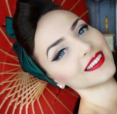 Pinup makeup red lip winged eyeliner