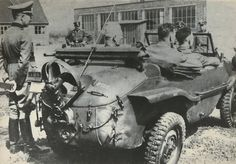 SS Officers gathering around soldiers in a VW Type 166 Schwimmwagen