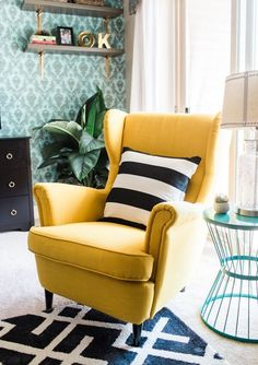 Dial up color in a bold way with a bright accent chair. The East Coast Creative lightened and brightened a formerly dark rental apartment with the help of a sunny yellow chair. Colorful Accent Chairs, Yellow Accent Chairs, Accent Chairs For Living Room, Living Room Decor, Living Room Yellow Accents, Navy Accent Chair, Yellow Armchair, Apartment Makeover, Vintage Chairs
