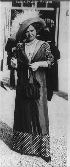 Women's fashions: Paris fashion, May 1911: polka-dot sleeves and hem.