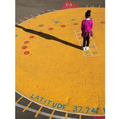 """... Parent, artist, and garden volunteer Margaret Chavigny created paintings on the playground illustrating the water cycle, plant parts, and a """"human sundial"""" laid out by volunteers, calibrated to the school's exact longitude and latitude. ..."""