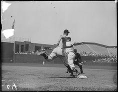 Washington Senators base runner Joe Kuhel (#5) is out by a step at first base as Boston Red Sox first baseman Eddie Morgan (#3) takes the throw at Fenway Park in 1934.